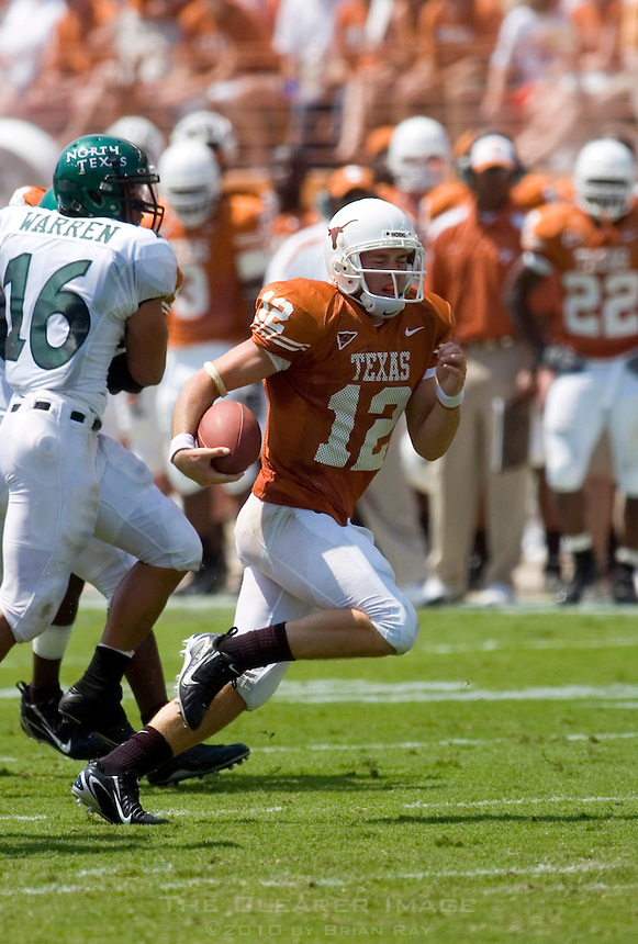 02 September 2006: University of Texas quarterback Colt McCoy dashes down field during the first half of the Longhorns game against the University of North Texas at Darrell K Royal Memorial Stadium in Austin, TX.