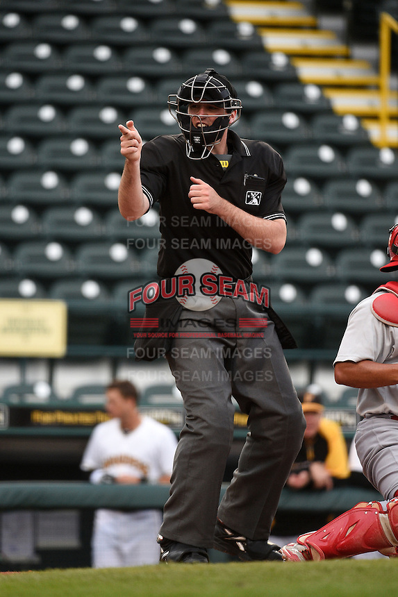 Home plate umpire Nate Tomlinson makes a call during a game between the Palm Beach Cardinals and Bradenton Marauders on April 8, 2014 at McKechnie Field in Bradenton, Florida.  Bradenton defeated Palm Beach 4-3.  (Mike Janes/Four Seam Images)