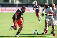 LAKE BUENA VISTA, FL - JULY 13: Edison Flores #10 of DC United and Chris Mavinga #23 of Toronto FC battle for the ball during a game between D.C. United and Toronto FC at Wide World of Sports on July 13, 2020 in Lake Buena Vista, Florida.