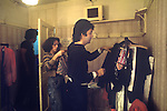 """Paul McCartney Wing Tour 1973. Wardrobe designer Paul chooseing clothes to wear. 1970s UK The photographs from this set were taken in 1975. I was on tour with them for a children's """"Fact Book"""". This book was called, The Facts about a Pop Group Featuring Wings. Introduced by Paul McCartney, published by G.Whizzard. They had recently recorded albums, Wildlife, Red Rose Speedway, Band on the Run and Venus and Mars. I believe it was the English leg of Wings Over the World tour. But as I recall they were promoting,  Band on the Run and Venus and Mars in particular."""