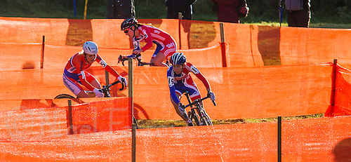 03 NOV 2012 - IPSWICH, GBR - Helen Wyman (GBR) (right) of Great Britain leads Sanne van Paassen (NED) (left) of the Netherlands and British team mate Gabriella Day (GBR) (centre) through a zig-zag section of the course during the elite women's European Cyclo-Cross Championships in Chantry Park, Ipswich, Suffolk, Great Britain. Wyman won the event after a sprint finish with van Paassen in a time of 43 minutes and 52 seconds making her the first Briton to win a senior international cyclo cross championship .(PHOTO (C) 2012 NIGEL FARROW)