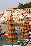Italy, Elba, Mariana, Beach umbrellas, Marina, Italian coastal town beach, Tuscan Archipelago, Italy, Mediterranean Sea; Europe,