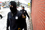 WATERBURY CT. - 18 December 2020-121820SV01-From left, Officers Robert Torres and Tammy Adler do a walking patrol on Willow Street in Waterbury Friday.<br /> Steven Valenti Republican-American
