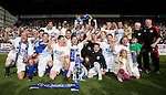 St Johnstone v Morton....02.05.09.The players celebrate winning the first division trophy in front of their fans.Picture by Graeme Hart..Copyright Perthshire Picture Agency.Tel: 01738 623350  Mobile: 07990 594431