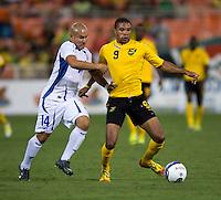Dennis Alas (14) of El Salvador tries to take ball away from Ryan Johnson (9) of Jamaica at RFK Stadium in Washington, DC.  Jamaica defeated El Salvador, 2-0.