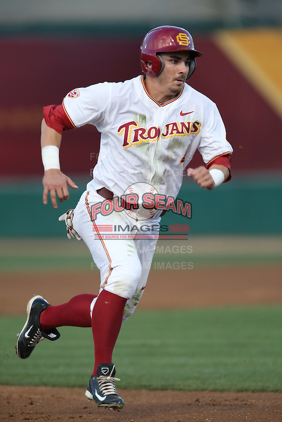 Bobby Stahel (4) of the Southern California Trojans runs the bases during a game against the Washington State Cougars at Dedeaux Field on March 13, 2015 in Los Angeles, California. Southern California defeated Washington State, 10-3. (Larry Goren/Four Seam Images)