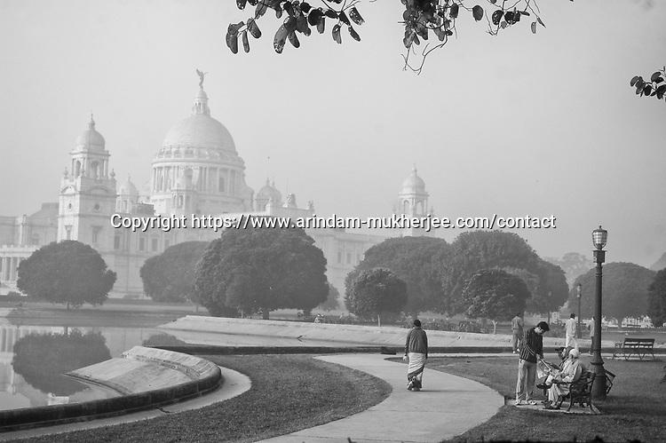Morning walkers at Victoria Memorial Hall in Kolkata, India.