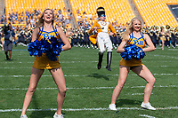 Members of the Pitt dance team perform before the game with Pitt band drum major Mike Ewan marching behind them. The Pitt Panthers defeated the Syracuse Orange 44-37 in overtime at Heinz Field in Pittsburgh, Pennsylvania on October 6, 2018.
