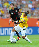 Shannon Boxx (l) of team USA and Cristiane of team Brazil during the FIFA Women's World Cup at the FIFA Stadium in Dresden, Germany on July 10th, 2011.