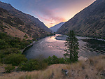 Sunrise color over the Snake River in Hells Canyon on the Oregon-Idaho border as viewed from the bench above Saddle Creek Camp