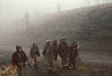 Iran 1982.Peshmergas in the fog on their way to the frontline of Baneh