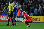 FIFA 2014 World Cup Qualifier - Wales v Croatia - Swansea - 26th March 2013 : Andy King of Wales sinks to his knees at the final whistle after being beaten by Croatia.