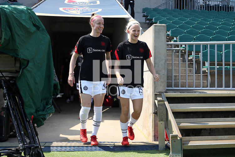 CARY, NC - SEPTEMBER 12: Becky Sauerbrunn #4 and Madison Pogarch #15 of the Portland Thorns FC take the field before a game between Portland Thorns FC and North Carolina Courage at Sahlen's Stadium at WakeMed Soccer Park on September 12, 2021 in Cary, North Carolina.