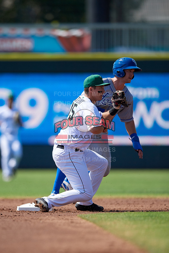 Augusta GreenJackets shortstop Shane Matheny (15) and base runner Jackson Lueck (9) look to the umpire for the call on a successful stolen base attempt during a South Atlantic League game against the Lexington Legends on April 30, 2019 at SRP Park in Augusta, Georgia.  Augusta defeated Lexington 5-1.  (Mike Janes/Four Seam Images)