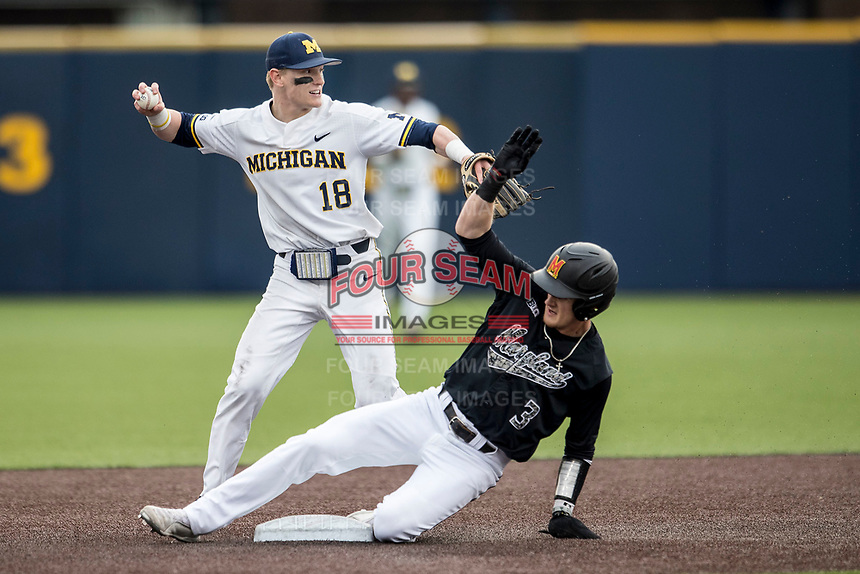 Michigan Wolverines shortstop Jack Blomgren (18) turns a double play against Maryland as Terrapins baserunner Zach Jancarski (3) slides into second base on April 13, 2018 in a Big Ten NCAA baseball game at Ray Fisher Stadium in Ann Arbor, Michigan. Michigan defeated Maryland 10-4. (Andrew Woolley/Four Seam Images)