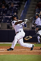 Tampa Yankees center fielder Tito Polo (18) follows through on a swing during a game against the Lakeland Flying Tigers on April 7, 2017 at George M. Steinbrenner Field in Tampa, Florida.  Lakeland defeated Tampa 5-0.  (Mike Janes/Four Seam Images)