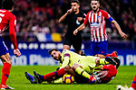 Lionel Messi of FC Barcelona (L) is challenged by Rodrigo Cascante of Atletico de Madrid (R) during the La Liga 2018-19 match between Atletico Madrid and FC Barcelona at Wanda Metropolitano on November 24 2018 in Madrid, Spain. Photo by Diego Souto / Power Sport Images