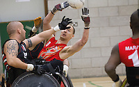 27 MAY 2013 - DONCASTER, GBR - Gavin Walker of the East Midlands Marauders passes during the 2013 Great Britain Wheelchair Rugby Nationals 5th / 6th place decider against the Leicester Tigers at The Dome in Doncaster, South Yorkshire .(PHOTO (C) 2013 NIGEL FARROW)