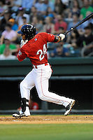 Second baseman Yoan Moncada (24) of the Greenville Drive in a game against the Augusta GreenJackets on Thursday, June 11, 2015, at Fluor Field at the West End in Greenville, South Carolina. The Cuban-born 19-year-old Red Sox signee has been ranked the No. 1 international prospect in baseball by Baseball America. Greenville won, 10-1. (Tom Priddy/Four Seam Images)
