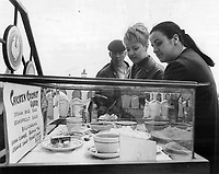 Expo visitors checking menu at burmese pavilion. Now at least you know what you're letting yourself in for.<br /> <br /> 1967<br /> <br /> PHOTO :  Doug Griffin - Toronto Star Archives - AQP