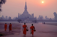 Images from the Book Journey Through Colour and Time.Early morning Buddhist Monks walking back to the Monastery Vientiane,Laos