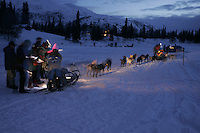 Dee Dee Jonrowe checks in during the early morning at the Finger Lake checkpoint.  Monday, March 7.  2005 Iditarod Sled Dog Race