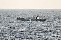 Sea Watch-2.<br /> Die Sea Watch-2 bei ihrer 13. SAR-Mission vor der libyschen Kueste.<br /> Im Bild: Ein Boot das sich als libysche Kuestenwache ausgibt bei einem Schlauchboot mit ca. 160 Menschen an Bord. Es ist unklar, ob die Soldaten nur den Motor stehlen wollen um ihn dann an die Schlepper zu verkaufen, oder ob sie das Boot wieder in libysches Hoheitsgewaesser schleppen wollen um die Menschen an die Schlepper verkaufen wollen.<br /> 20.10.2016, Mediterranean Sea<br /> Copyright: Christian-Ditsch.de<br /> [Inhaltsveraendernde Manipulation des Fotos nur nach ausdruecklicher Genehmigung des Fotografen. Vereinbarungen ueber Abtretung von Persoenlichkeitsrechten/Model Release der abgebildeten Person/Personen liegen nicht vor. NO MODEL RELEASE! Nur fuer Redaktionelle Zwecke. Don't publish without copyright Christian-Ditsch.de, Veroeffentlichung nur mit Fotografennennung, sowie gegen Honorar, MwSt. und Beleg. Konto: I N G - D i B a, IBAN DE58500105175400192269, BIC INGDDEFFXXX, Kontakt: post@christian-ditsch.de<br /> Bei der Bearbeitung der Dateiinformationen darf die Urheberkennzeichnung in den EXIF- und  IPTC-Daten nicht entfernt werden, diese sind in digitalen Medien nach §95c UrhG rechtlich geschuetzt. Der Urhebervermerk wird gemaess §13 UrhG verlangt.]