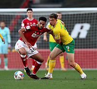 31st October 2020; Ashton Gate Stadium, Bristol, England; English Football League Championship Football, Bristol City versus Norwich; Jordan Hugill of Norwich Ciy holds onto the arm of Zak Vyner of Bristol City