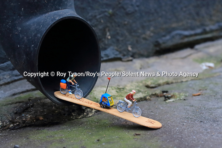 Pictured:  Urban Adventure<br /> <br /> Tiny figurines give a new perspective on everyday objects as they are posed interacting with them in their miniature world.  Artist Roy Tyson creates witty and intriguing imagery with customised miniature figures, under the name Roy's People.<br /> <br /> Since 2012, he has been photographing his miniature world on the streets of London and beyond.  SEE OUR COPY FOR DETAILS.<br /> <br /> Please byline: Roy Tyson/Roy's People/Solent News<br /> <br /> © Roy Tyson/Roy's People/Solent News & Photo Agency<br /> UK +44 (0) 2380 458800