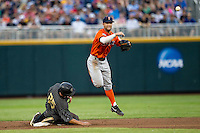 Cal State Fullerton Titans second baseman Taylor Bryant (1) turns a double play as Vanderbilt Commodores baserunner Karl Ellison (25) slides into second during the NCAA College baseball World Series on June 14, 2015 at TD Ameritrade Park in Omaha, Nebraska. The Titans were leading 3-0 in the bottom of the sixth inning when the game was suspended by rain. (Andrew Woolley/Four Seam Images)