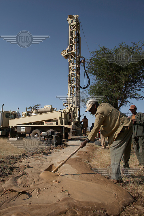Drilling for water at Koye Tajaba Village. Here a bore hole is being created, with the rig boring down to a depth of approximately 160 meters to the underground water table. Once tapped a 3km pipeline extension will transport the water to a distribution point. The bore hole is expected to supply 1,500 beneficiaries.