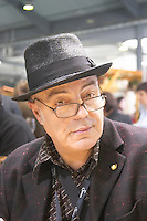Michel Smith, French author and wine writer, France, wearing a black hat and black reading glasses