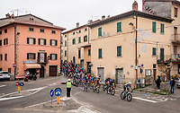 peloton rolling through town<br /> <br /> Stage 3 from Monticiano to Gualdo Tadino (219km)<br /> <br /> 56th Tirreno-Adriatico 2021 (2.UWT) <br /> <br /> ©kramon