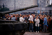 Moscow, Soviet Union<br /> August 21, 1991<br /> <br /> Pro-Yeltsin supporters oppose tanks at the Parliament building barricades during the Soviet coup d'état attempt (August 19-21, 1991), also known as the August Putsch or August Coup. A small group of the Soviet government officials briefly deposed president Mikhail Gorbachev in an attempted to take control of the country. The coup leaders were hard-line members of the Communist Party (CPSU) who felt that Gorbachev's reforms had gone too far in dispersing the central government's power to the republics - better known as perestroika. The coup collapsed in three days, and Gorbachev returned to power, crushing the Soviet leader's hopes that the union could be held together in a decentralized form.