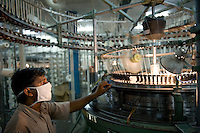 "Südasien Asien Indien IND Madhya Pradesh , Verarbeitung von fairtrade Baumwolle bei Maral Overseas Ltd. -  Textilwirtschaft Textilindustrie Baumwolle xagndaz | .South Asia India Madhya Pradesh  Maral Overseas Ltd. textile factory process fairtrade cotton.  -  agriculture textile industry .| [ copyright (c) Joerg Boethling / agenda , Veroeffentlichung nur gegen Honorar und Belegexemplar an / publication only with royalties and copy to:  agenda PG   Rothestr. 66   Germany D-22765 Hamburg   ph. ++49 40 391 907 14   e-mail: boethling@agenda-fototext.de   www.agenda-fototext.de   Bank: Hamburger Sparkasse  BLZ 200 505 50  Kto. 1281 120 178   IBAN: DE96 2005 0550 1281 1201 78   BIC: ""HASPDEHH"" ,  WEITERE MOTIVE ZU DIESEM THEMA SIND VORHANDEN!! MORE PICTURES ON THIS SUBJECT AVAILABLE!! INDIA PHOTO ARCHIVE: http://www.visualindia.net ] [#0,26,121#]"