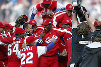 The Cuban national team celebrates win against the Dominican Republic team during the World Baseball Championships at Petco Park in San Diego,California on March 18, 2006. Photo by Larry Goren/Four Seam Images