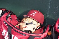 Alabama Crimson Tide hat and bag laying in the dugout at Baum Stadium during the NCAA baseball game against the against the Arkansas Razorbacks on March 21, 2014 in Fayetteville, Arkansas.  The Alabama Crimson Tide defeated the Arkansas Razorbacks 17-9.  (William Purnell/Four Seam Images)