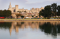 Pope's Palace in Avignon and the Rhone river with the Palace reflected in the water surface of the river Avignon, Vaucluse, Provence, Alpes Cote d Azur, France, Europe