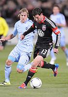 D.C. United midfielder Chris Pontius (13) goes against Sporting Kansas City defender Chance Myres (7) Sporting Kansas City defeated D.C. United  1-0 at RFK Stadium, Saturday March 10, 2012.