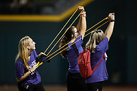 """Members of the """"Dash Pack"""" launch t-shirts into the stands between innings of the High-A East game between the Greensboro Grasshoppers and the Winston-Salem Dash at Truist Stadium on August 13, 2021 in Winston-Salem, North Carolina. (Brian Westerholt/Four Seam Images)"""