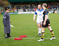 Photo: Richard Lane/Richard Lane Photography. London Wasps v Bath Rugby. LV=Cup. 14/11/2010. An RAF Bugler receives Remembrance Day Wreaths from captains,  David Flatman of Bath and Tom Rees of Wasps.