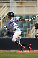 Luis Curbelo (16) of the Kannapolis Intimidators follows through on his swing against the Greensboro Grasshoppers at Kannapolis Intimidators Stadium on August 5, 2018 in Kannapolis, North Carolina. The Intimidators defeated the Grasshoppers 9-0 in game two of a double-header.  (Brian Westerholt/Four Seam Images)