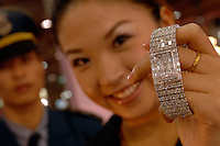 An assistant holds-up a watch encrusted with 200 diamonds worth 2 million Chinese rnb at the Guangzhou Luxury Goods Fair in China.