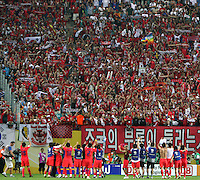 Korea Republic players greet their fans at the end of the game. The Korea Republic and France played to a 1-1 tie in their FIFA World Cup Group G match at the Zentralstadion, Leipzig, Germany, June 18, 2006.