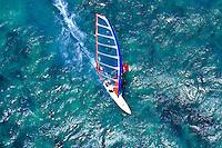 A windsurfer windsurfing at Kanaha beach park on Maui