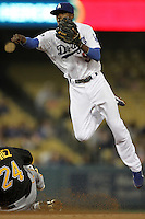 Los Angeles Dodgers shortstop Dee Gordon #9 throws to first base after forcing out Pittsburgh Pirates third baseman Pedro Alvarez #24 at second base at Dodger Stadium on September 16, 2011 in Los Angeles,California. Los Angeles defeated Pittsburgh 7-2.(Larry Goren/Four Seam Images)