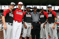 August 7, 2009:  Hall of Fame member Ernie Banks with Under Armour All-America team members Alex Ramsay, Garin Cecchini, Chavez Clarke, J.D. Williams, Cayle Shambaugh at Wrigley Field in Chicago, IL.  Photo By Mike Janes/Four Seam Images