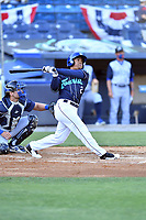Asheville Tourists third baseman Enmanuel Valdez (2) swings at a pitch during a game against the Brooklyn Cyclones on May 6, 2021 at McCormick Field in Asheville, NC. (Tony Farlow/Four Seam Images)