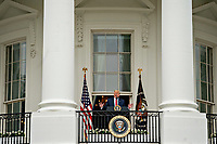 United States President Donald J. Trump speaks from the Blue Room Balcony of the White House during a Rolling to Remember ceremony honoring the nation's veterans and prisoners of war/missing in action (POW/MIA) in Washington, D.C., U.S., on Friday, May 22, 2020. Trump didn't wear a face mask during most of his tour of Ford Motor Co.'s ventilator facility Thursday, defying the automaker's policies and seeking to portray an image of normalcy even as American coronavirus deaths approach 100,000. <br /> Credit: Andrew Harrer / Pool via CNP/AdMedia