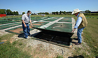 Al Drinkwater (left), a volunteer environmental quality consultant, and Heath Ward, executive director of Springdale Water Utilities, inspect equipment Friday, Aug. 21, 2020, at the former Bethel Heights wastewater treatment facility. The Benton County Election Commission certified that the results of an Aug. 11 election to annex Bethel Heights into Springdale. Visit nwaonline.com/200823Daily/ for today's photo gallery.<br /> (NWA Democrat-Gazette/Andy Shupe)